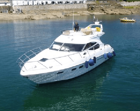 Large yacht with marine diesel engine idling offshore